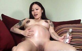 9th month tiny Asian pregnant lactating