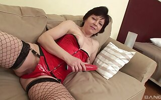 Mature wife Eva in fishnet stockings fucked by a dick and a dildo